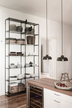 Great storage unit with vintage lamp in kitchen