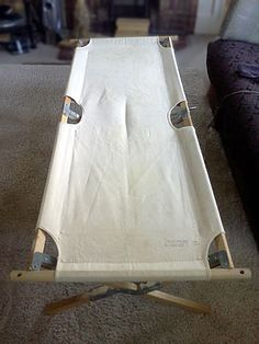 How do you camp overnight without sleeping on plastic? Answer: a wood and canvas camping cot!