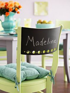 "Chair backs coated with chalkboard paint provide erasable name ""cards"" for a dinner party."