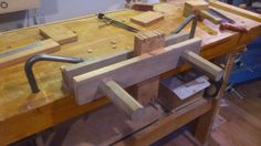 Shop-made moxon vise.  Walnut with maple screws.  Use a Beall thread box to make the screws.