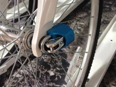 Simply put it's a fit and forget mechanism which discourages thieves from stealing your bike wheels and you carrying less locks.