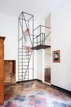 """A very small apartment within a very """"Milanese"""" building dated 1900. Two rooms plus a bath room, characterized by a narrow footprint com- pared to the quite high ceiling. Windows, doors, and above all the floor tiles, had finishes and materials survived t"""