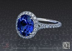Halo engagement ring featuring a 3.24 carat oval cut blue sapphire.