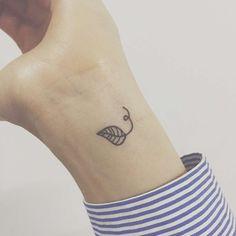 tiny leaf tattoo on wrist