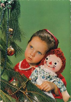 This is me on Christmas morning with my Raggedy Ann doll.
