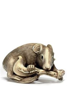 An Ivory Netsuke  SIGNED SHOKO, MEIJI PERIOD (LATE 19TH CENTURY)
