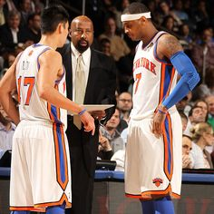Interim coach Mike Woodson talks strategy with Jeremy Lin (left) and Carmelo Anthony. #NBA