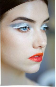 Bright, space-age shiny makeup.