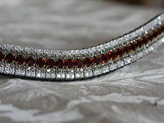 Equiture - Garnet, black diamond and clear megabling curve browband, $114.62 (http://www.equiture.biz/garnet-black-diamond-and-clear-megabling-curve-browband/)