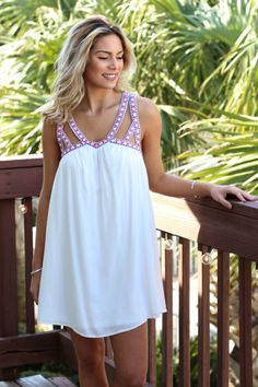 White babydoll dress with cutouts, aflowy silhouette and fully lined. Material is polyester Model Ali is 5'9 wearing size small  Small Medium Large Bust 17 18