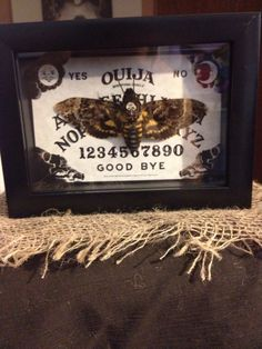 Deaths death head moth ouija board backround by Uncletrashcan, $100.00