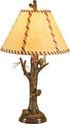 The pine cone accented floor lamp and its distinguished glass table will dress up your favorite outdoor-themed room, lodge or cabin.