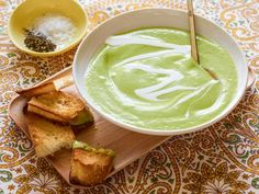 Marcela purees ripe avocados with chicken broth, lemon juice, cilantro, onions and water to make her creamy cold soup.
