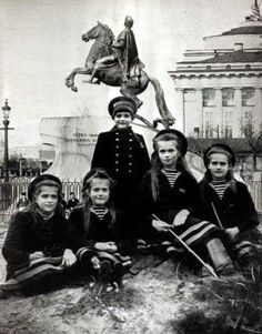 The Romanov children and the monument to Peter the Great of Russia in the background, early 20th century.