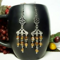 Only $6.59! - SALE Vibrant Silver Oval Filigree Connector Charms w/Dangling 3 Linked Rosary Style Strands of Small Czech Translucent Gold Glass Heart Beads & Golden Amber Round Glass Faceted Beads Dangling From a Silver Filigree 3 Loop Chandelier Earrings - Under $10 Chandelier Earrings - FREE USA SHIPPING https://www.etsy.com/listing/399784495/sale-silver-oval-filigree-connector