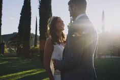 Lovely dusk couple photography  -  Image by  Sara Lincoln Photography - Rime Arodaky gown for a Tuscany wedding with a white and grey colour scheme and bridesmaid dresses from ASOS.