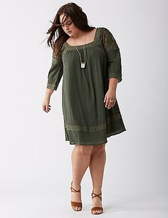 The one-and-done dress that's ready at the drop of an invite. Sheer shoulders. Lined. Square neckline in front and back. lanebryant.com