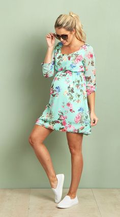 One of our favorite dresses this season, and just in time for spring, this gorgeous floral chiffon maternity dress is perfect for any occasion. A beautiful hue and floral print make this dress the ultimate feminine essential, from baby showers to casual wear. Style this dress with strappy sandals and a statement necklace to complete the look.