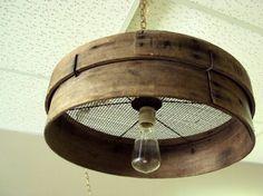 Old grain sieve repurposed into a primitive chandelier.-26 Breathtaking DIY Vintage Decor Ideas