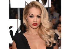 Rita Ora looked straight up Old Hollywood glah-mor-ous at the MTV Movie Awards with her millennial Veronica Lake, flipped-back waves. For your next big dramatic moment, work a mega-volumizing, heat-activated mousse into wet hair from roots to ends and blow dry. Then, part your hair down the middle (yes, yes, we'll get to the side part next), curl one-inch sections outward and away from your face. Leave the sections at the top left last to curl inward, toward your face. Then create a slight…