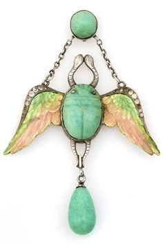 An Art Nouveau Silver, Green Stone and Paste Enamelled Winged Scarab Brooch. #ArtNouveau #scarab #brooch