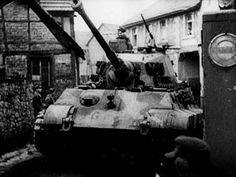King Tiger 008 passes through the German town of Tondorf during the initial advance on 16 December 1944.