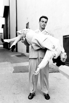 Elizabeth Taylor and Montgomery Clift outside at Paramount Studios during break, by Peter Stackpole, 1950.