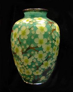 """Beautiful Japanese plique-a-jour cloisonne vase with an all over design of blossoming plum branches, lovely turquoise ground, no cracks, Meiji/Taisho Period (early 20th century). Size: 5 1/4"""" high."""