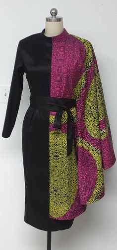 Asymetrical African Print Black Contrast Fabric Fitted Dress with Attached Cape long Sleeves and rolled collar. DETAILS: African Print and Black Stretch Fabric Care Instructions: Dry Clean Only. Press Visit my shop: African American Fashion, African Inspired Fashion, African Print Fashion, Africa Fashion, Ethnic Fashion, Look Fashion, Fashion Outfits, Womens Fashion, Fashion Tips