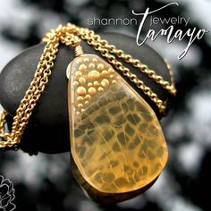 "Agate Slab Pendant by Shannon T Jewelry  Available for purchase at: http://ift.tt/1Ubl3Om  A golden yellow agate slab hangs from a 16"" gold plated rolo chain and is finished with a gold plated lobster clasp. The 1 1/2"" long x 15/16"" wide agate is a warm inviting yellow with a beautiful lattice or lace-like pattern in the stone. It has a free form shape that feels a bit raw and earthy despite being polished to a high sheen. I've adorned the stone with golden orbs that remind me of champagne…"