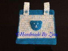 Crochet cot pocket/tidy. Measures approx. 28 x 28cm exc. loops.  Can be made in a choice of colours.    £18
