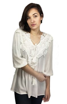 Crotchet White Blouse - Spring Ready. Pair with light distressed jeans for an edgy look.
