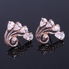 Pair of Charming Rhinestone Embellished Peacock Stud Earrings