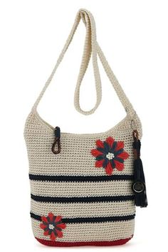 A sweet and subtle take on the americana trend, the Casual Classics crossbody in anthem flower features navy blue stripes on natural crochet, with red, white and blue raffia flower embellishments. http://bit.ly/1U5ItPA