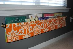 kids' book storage/ display Clever and easy to do. Curtain rod, pink sheet cut up, doubled over and tied in place.