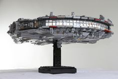Here's a total shot of the falcon on the stand. Heavy but steady. Millennium Falcon, Spaceship, Lego, Space Ship, Spacecraft, Craft Space, Space Shuttle, Legos, Spaceships