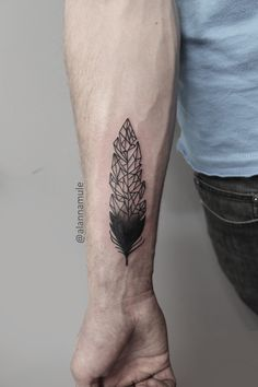 Gorgeous forearm Feather Tattoo which fades into a Low Poly style.