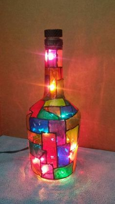 Locating the best lamp for your home can be hard because there is such a wide variety of lamps available. Find the perfect living room lamp, bed room lamp, table lamp or any other type for your particular room. Painted Glass Bottles, Glass Bottle Crafts, Wine Bottle Art, Lighted Wine Bottles, Diy Bottle, Decorated Bottles, Bottle Lights, Liquor Bottles, Glass Painting Designs