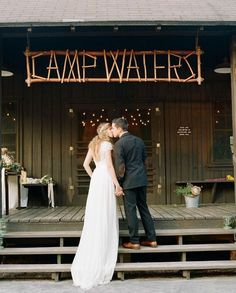 For a couple with a summer camp themed wedding, why not relive those camp crafts? This couple created a DIY woodsy sign to hang over their wedding reception venue AKA the mess hall.