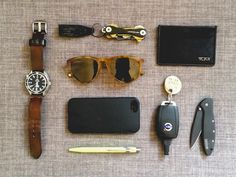 """Omega Seamaster Professional Planet Ocean 42mm on handmade leather strap Keys on KeySmart 2.0  with Nite-Ize KeyCLIPse composite locking pocket clip Tumi Ticon Flat Card Case (front pocket carry) Warby Parker GriffinSunglasses in blonde tortoise iPhone 5S in Spigen NeoHybrid case Volvo C30 key on self-made keychain that says """"It Is What It Is"""" Kershaw Leek knife Caran D'ache Ballpoint Pen in neon yellow  Creative Director in Oakland, CA  [[MORE]]"""