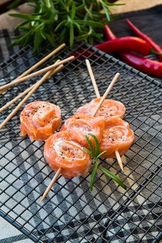 Goat cheese filled salmon rolls on the bbq