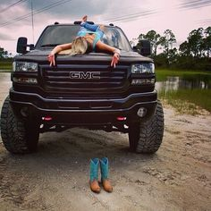 A lifted truck and a country girl.not a Chevy but. Hey Y'all Blowout Sale, OFF! Support and Roll Coal For Diesel Dave. Prepare yourself for the nicest Diesel gear on the planet! Lifted Chevy Trucks, Gm Trucks, Cool Trucks, Pickup Trucks, Muddy Trucks, Chevy Duramax, Chevy 4x4, Diesel Trucks, Cummins Diesel