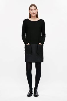 The contrast fabric on the skirt of this easy wool dress adds structure to the look. Merino dress with frill pockets, $125 at Cos | Washingtonian