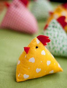 """If you're looking for a simple pattern for these, search online for """"nets for tetrahedrons"""". Remember to add in seam allowances, as well as the beak and the comb."""