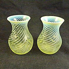 Pair of Vaseline Glass Vases, Opal Glass Rims.