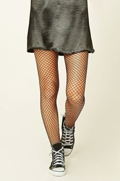 A pair of lightweight knit fishnet tights featuring an elasticized waist.