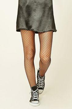A pair of lightweight knit fishnet tights featuring an elasticized waist.