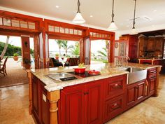Love the red stain on the cabinets. Also love, love, love the french doors opening onto the patio.