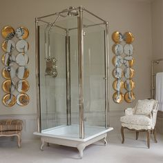 Free standing glass shower-what a good idea no worring about water behind walls