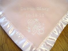 Personalized baby girl blanket with embroidered baby rattle design. Baby's name and date of birth are stitched on the blanket. Decorative stitches are sewn on the satin binding. This blanket will be treasured forever. Embroidered Baby Blankets, Beautiful Baby Girl, Personalized Baby Blankets, Baby Girl Blankets, Baby Rattle, Quilting Projects, Baby Items, Embroidery Designs, Monogram